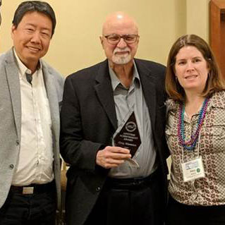 Kent Wong and Mary Bellham present Greg Mantsios with the UALE 2018 Outstanding Contribution to the Field of Labor Education award